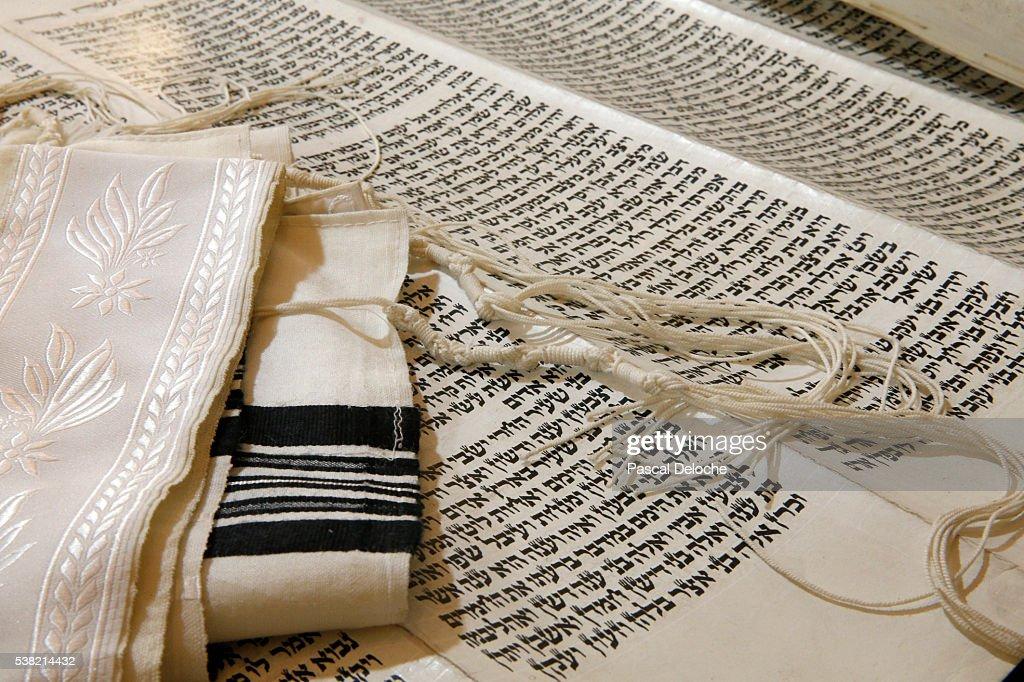 Torah scroll and Tallit, Jewish prayer shawl. : Stock Photo