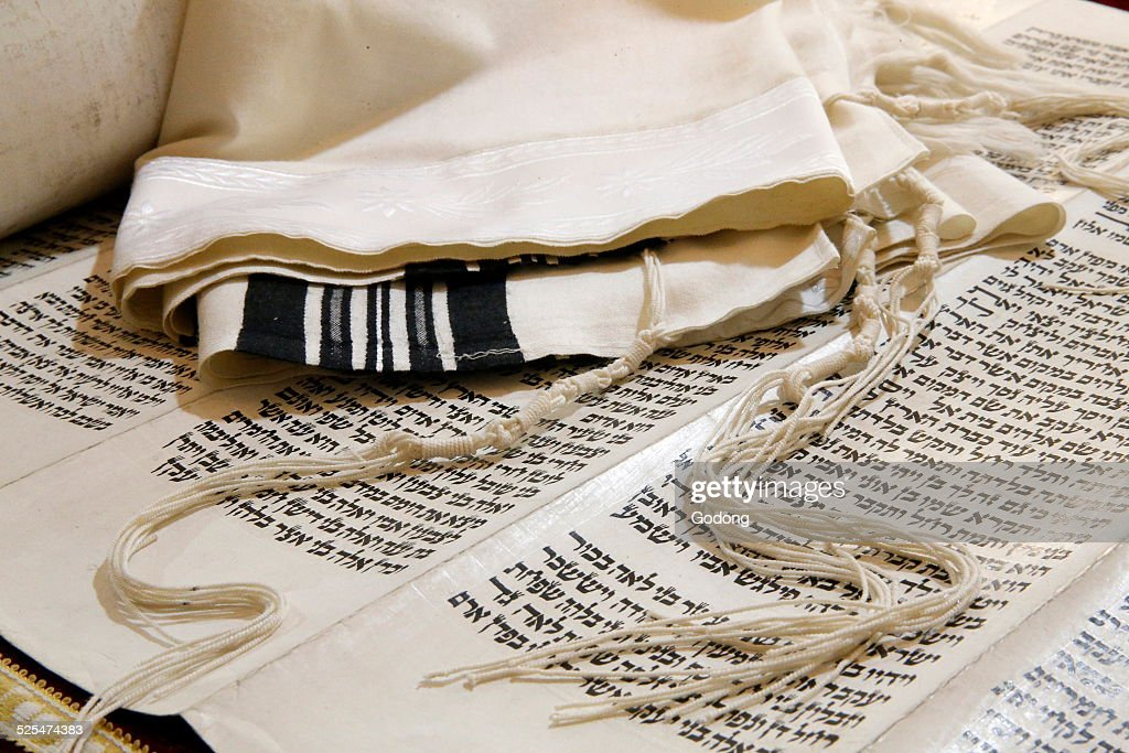 Torah scroll, Tallit, Jewish prayer shawl and Tzittzit, knotted ritual fringes.