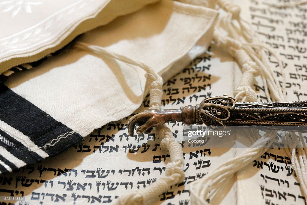 Torah scroll, Yad, Torah pointer, and Tallit, Jewish prayer shawl.