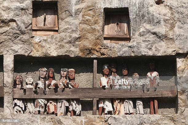 Torajan cliff burial effigy figures (tau tau)