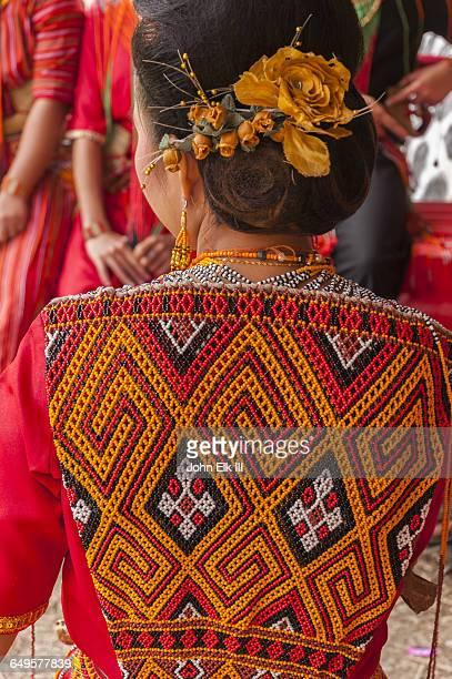 Torajan funeral celebration, woman in trad dress