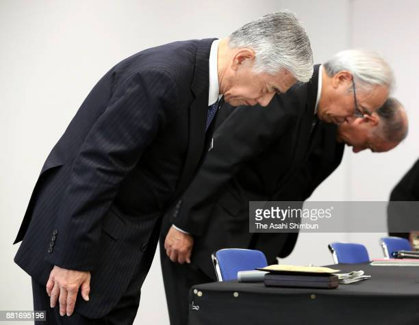 Toray Industries Inc President Akihiro Nikkaku bows for apology during a press conference on November 28 2017 in Tokyo Japan Toray Industries Inc...