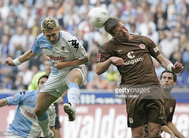 Torben Hoffmann of Munich and Marcel Eer of St Pauli battle for the balll during the 2nd Bundesliga match between TSV 1860 Munich and FC St Pauli on...