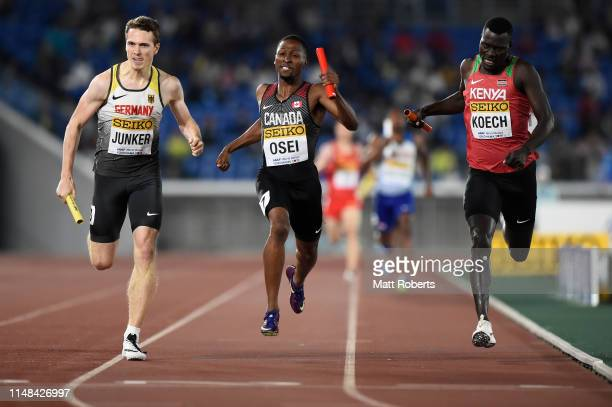 Torben Junker of Germany Philip Osei of Canada and Aron Koech of Kenya compete during round 1 of the Mixed 4x400m Relay on day one of the IAAF World...