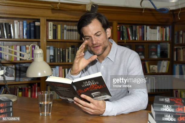 Torben Liebrecht reads a book on set during the RTL Event Movie 'Das Joshua-Profil' Photocall In Berlin on August 22, 2017 in Berlin, Germany.