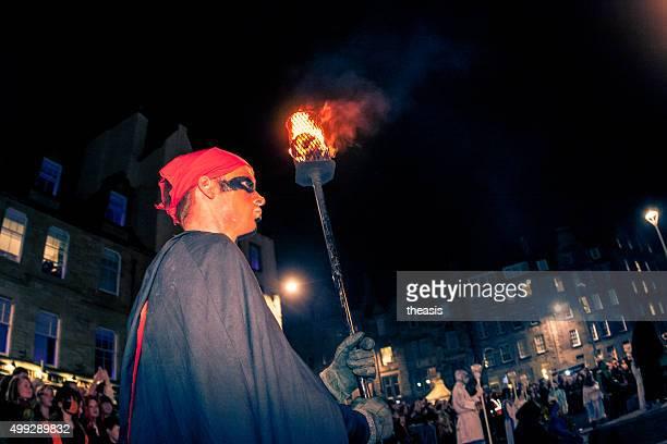torch bearer at the samhuinn fire festival, edinburgh - beltane fire festival stock pictures, royalty-free photos & images