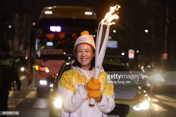 A torch bearer carries the PyeongChang 2018 Winter Olympics torch during the PyeongChang 2018 Winter Olympics torch relay on January 16 2018 in Seoul...