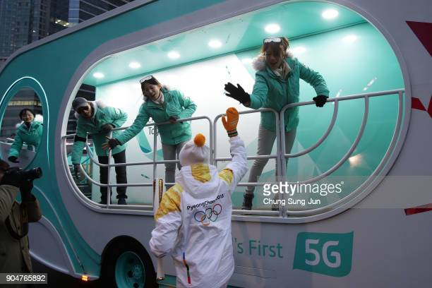 Torch bearer cheers during the PyeongChang 2018 Winter Olympic Games torch relay on January 14 2018 in Seoul South Korea