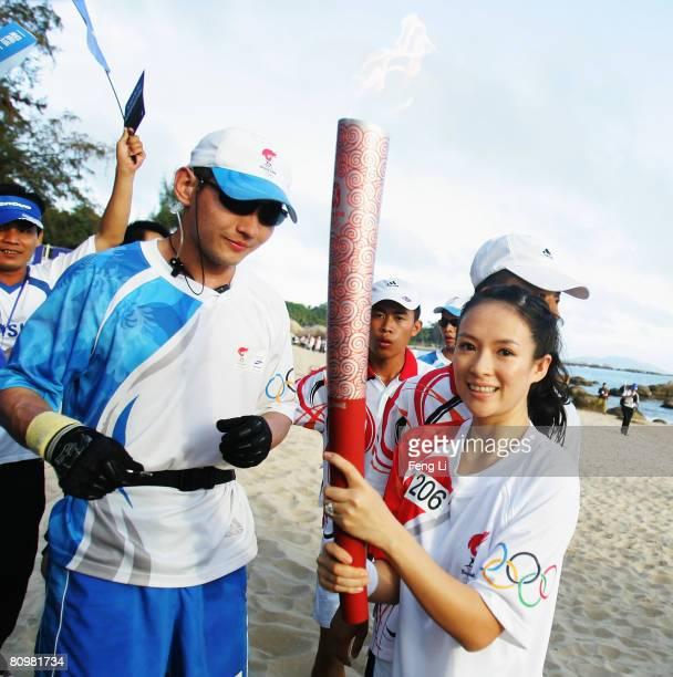 Torch bearer Chinese actress Ziyi Zhang carries the Olympic Torch during the Olympic Torch Relay on May 4 2008 in Sanya of Hainan province China The...