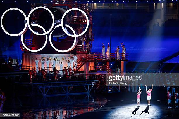 Torch Bearer Former Table Tennis Champion Zhang Jike and London Olympics women's 10meter platform and 10m platform champion Chen Ruolin runs with the...