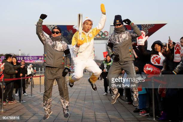 Torch bearer holds the PyeongChang 2018 Winter Olympics torch during the PyeongChang 2018 Winter Olympic Games torch relay on January 14 2018 in...