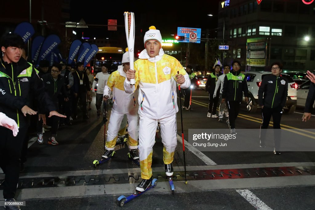 Torch bearer Kim Magnus holds the PyeongChang 2018 Winter Olympics torch during the PyeongChang 2018 Winter Olympic Games torch relay on November 4, 2017 in Busan, South Korea.