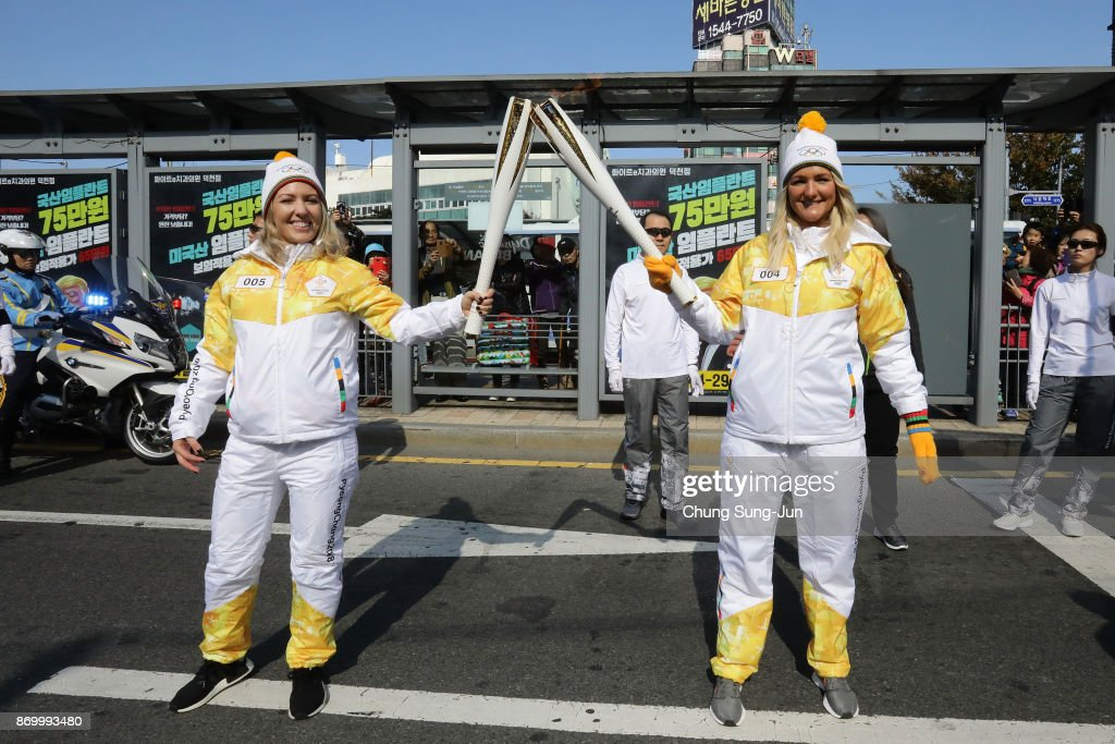 Torch bearer Sarah Gavey (R) and Jane Henchoz (L) hold the PyeongChang 2018 Winter Olympics torch during the PyeongChang 2018 Winter Olympic Games torch relay on November 4, 2017 in Busan, South Korea.
