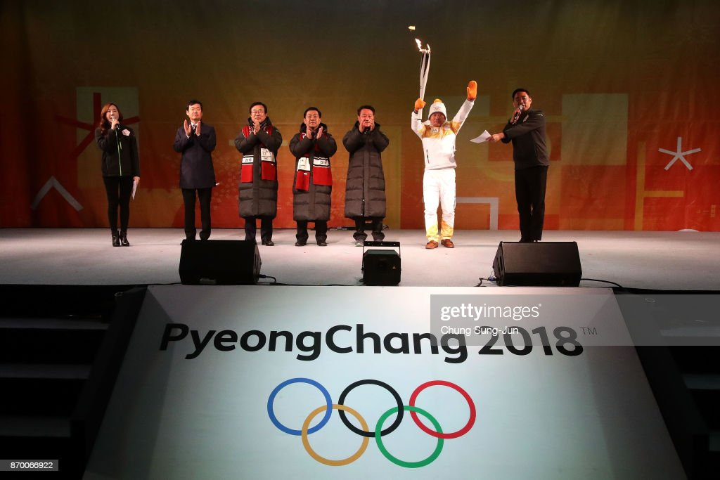 Torch bearer Yang Jung-Mo holds the PyeongChang 2018 Winter Olympics torch during the PyeongChang 2018 Winter Olympic Games torch relay on November 4, 2017 in Busan, South Korea.