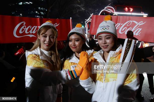 Torch bearers pose with the PyeongChang 2018 Winter Olympics torch during the PyeongChang 2018 Winter Olympics torch relay on January 16 2018 in...