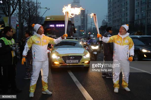 Torch bearers pose with the PyeongChang 2018 Winter Olympics torch during the PyeongChang 2018 Winter Olympic Games torch relay on January 16 2018 in...