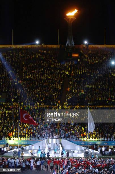 A torch burns over Ataturk Stadium in the Aegean port city of Izmir western Turkey 11 August 2005 during the opening ceremony of the 23rd World...