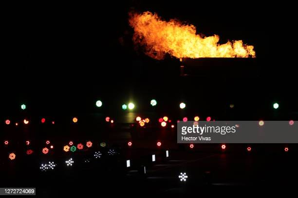 A torch is lit during the Independence Day celebrations on September 15 2020 in Mexico City Mexico This year the El Zocalo square remains closed for...