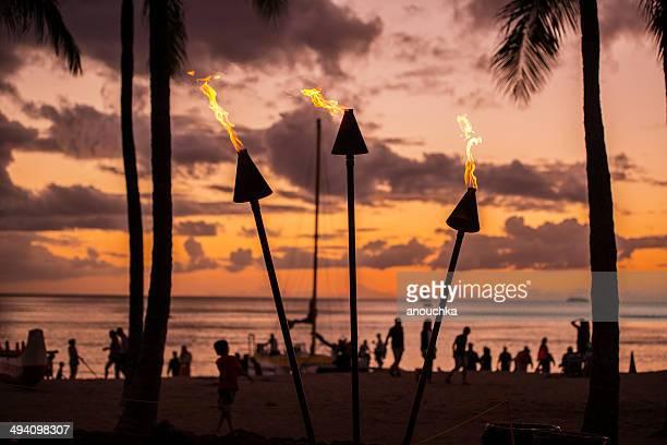 torch lighting in waikiki on sunset - waikiki stock pictures, royalty-free photos & images