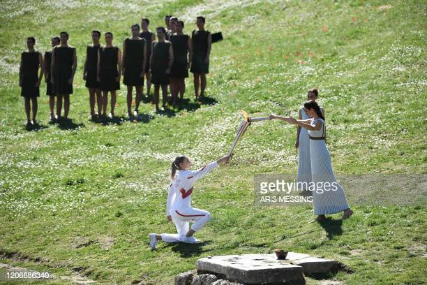Torchbearer Greece's Anna Korakaki , Rio 2016 gold medallist in the 25m pistol shooting, receives the Olympic flame during the flame lighting...