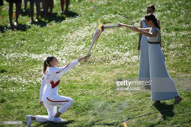 Torchbearer Greece's Anna Korakaki Rio 2016 gold medallist in the 25m pistol shooting receives the Olympic flame during the flame lighting ceremony...