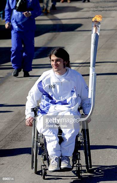 Torchbearer Richard Castaldo carries the Olympic Flame during the 2002 Salt Lake Olympic Torch Relay January 31 2002 in Littleton CO Castaldo was...