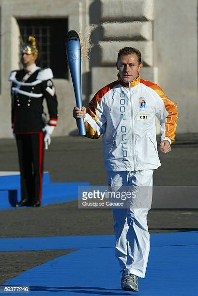 Torchbearer Stefano Baldini Italian Gold Medalist carries the Olympic Torch during the Torino 2006 Olympic Torch Relay while leaving the Quirinale...