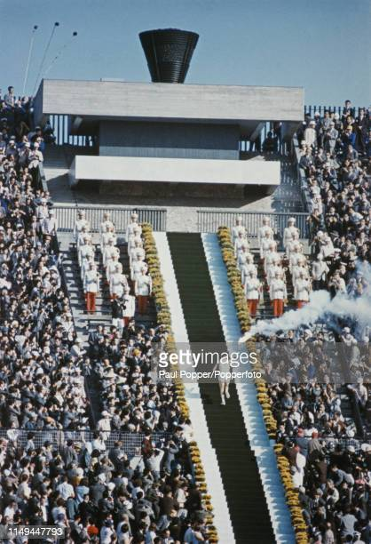 Torchbearer Yoshinori Sakai who was born in Hiroshima on the day the atomic bomb was dropped on the city climbs a flight of steps up to the Olympic...