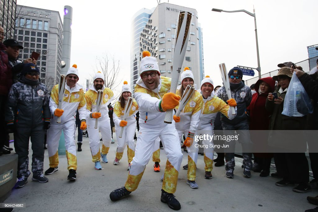 Torchbearers cheer during the PyeongChang 2018 Winter Olympic Games torch relay on January 13, 2018 in Seoul, South Korea.