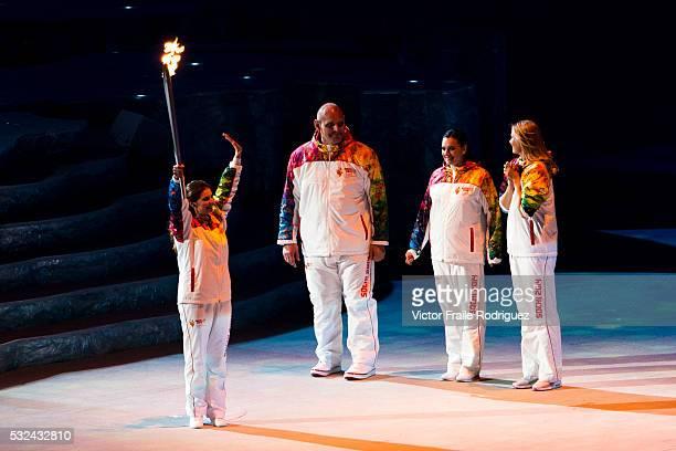 Torchbearers Elena Isinbaeva Maria Sharapova Alexander Karelin and Alina Kabaeva during the Opening Ceremony of the 2014 Sochi Olympic Winter Games...