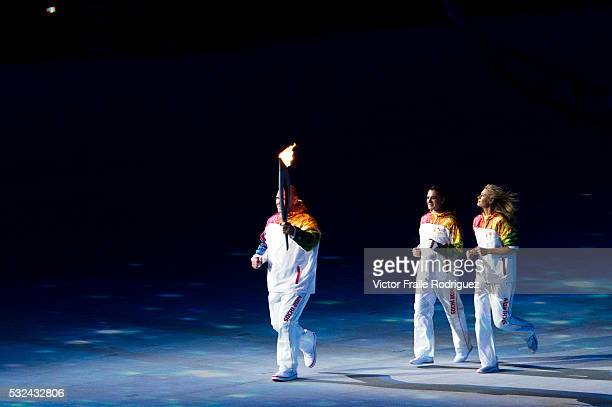 Torchbearers Elena Isinbaeva Maria Sharapova Alexander Karelin during the Opening Ceremony of the 2014 Sochi Olympic Winter Games at Fisht Olympic...