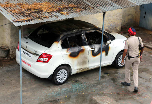 A torched car inside the office of income tax office in Mansa that was set affire by protesting Dera Sacha Sauda protesters at Mansa on August 25...