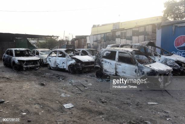 Torched vehicles at Koregaon after the clashes between Dalit groups and supporters of rightwing Hindutva organisations broke out during the 200th...