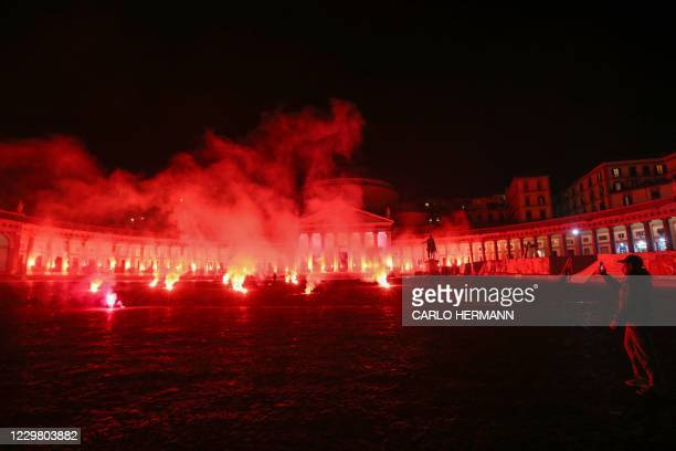 Torches are lit on Piazza del Plebiscito in Naples on November 26, 2020 to mourn the death of late Argentinian football legend Diego Maradona. -...