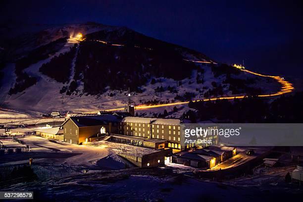 Torches descent at night in Nuria ski resort.