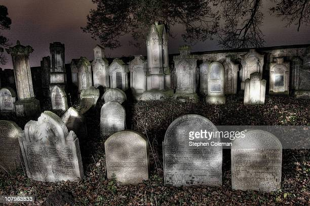 Torchlit graves in an overgrown and isolated cemetery in Sedlicky, near Jicin, Czech Republic