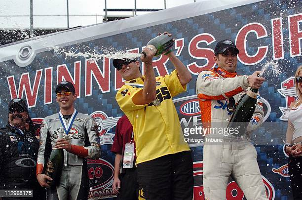 Torco Racing Fuels NHRA 66 Nationals winners Gary Scelzi Andrew Hines Jeg Coughlin and Larry Dixon celebrate at the Chicagoland Speedway in Joliet...