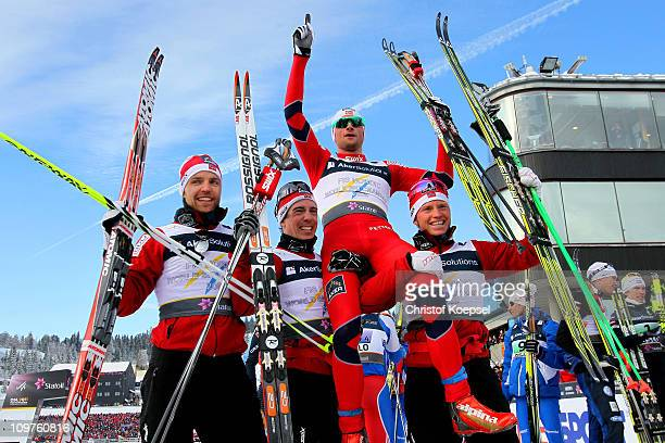 Tord Asle Gjerdalen, Eldar Roenning, Petter Northug and Martin Johnsrud Sundby of Norway celebrate after winning the gold medal in the Men's Cross...
