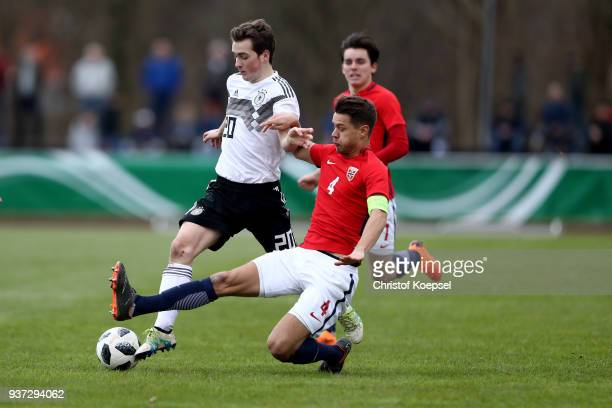 Tord Salte of Norway challenges Yari Otto of Germany during the UEFA Under19 European Championship Qualifier match between Germany and Norway at...