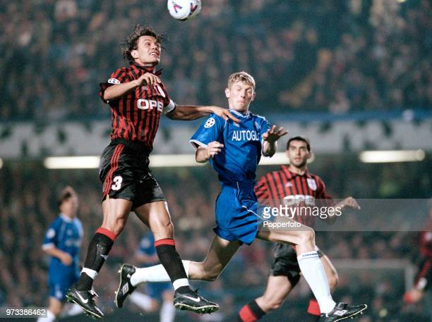 Tore Andre Flo of Chelsea and Paolo Maldini of AC Milan challenge for the ball in the air during the UEFA Champions League Group H match at Stamford...