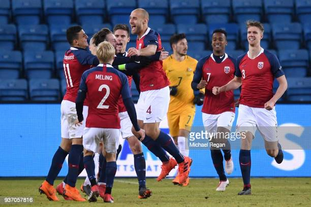 Tore Reginiussen of Norway is congratulated by team mates after scoring his sides second goal to make it 21 to Norway during the International...
