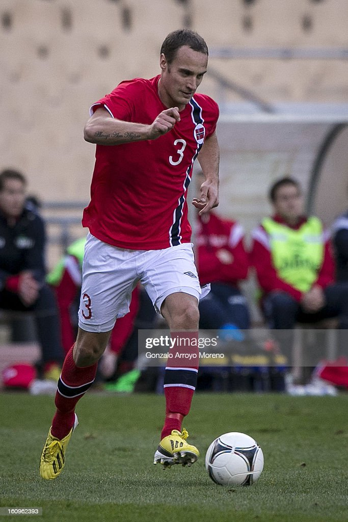 Tore Reginiussen of Norway with the ball during the international friendly football match between Norway and Ukraine at Estadio Olimpico de Sevilla on February 6, 2013 in Seville, Spain.