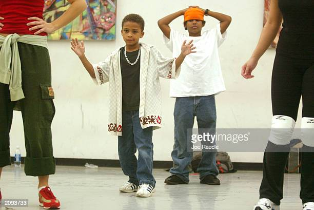 Toren Cartwright and Julian WIlliams participate in a HipHop dance class during the 25th Birthday of the Florida Dance Festival on June 18 2003 at...