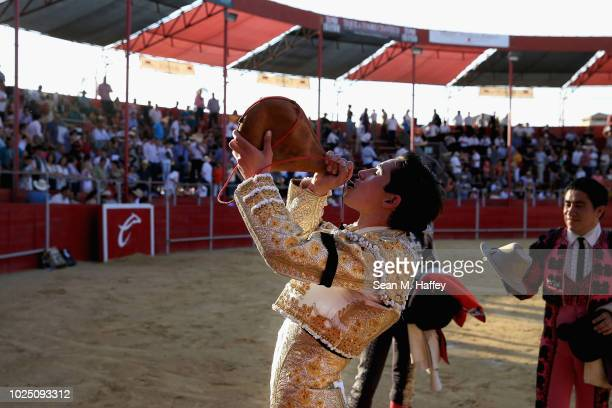 Torero Fermin Espinoza of Mexico drinks wine from a traditional Spanish Bota bag at the conclusion of the day's bullfights at Caliente Plaza de Toros...