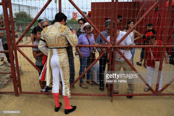 Torero Fermin Espinoza of Mexico greets fans prior to an afternoon bullfight at Caliente Plaza de Toros on July 8 2018 in Tijuana Mexico Traditional...