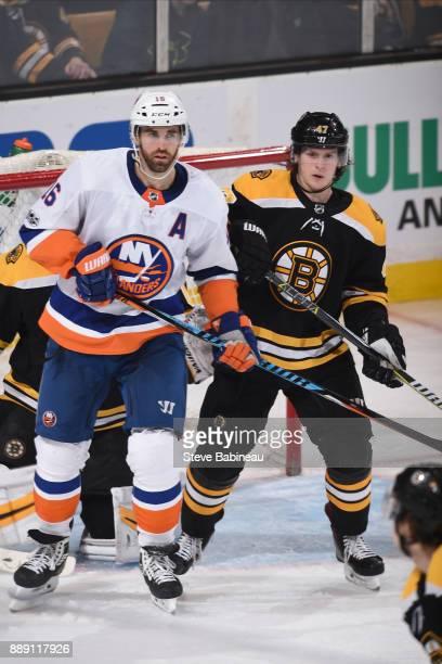 Torey Krug of the Boston Bruins against Andrew Ladd of the New York Islanders at the TD Garden on December 9 2017 in Boston Massachusetts