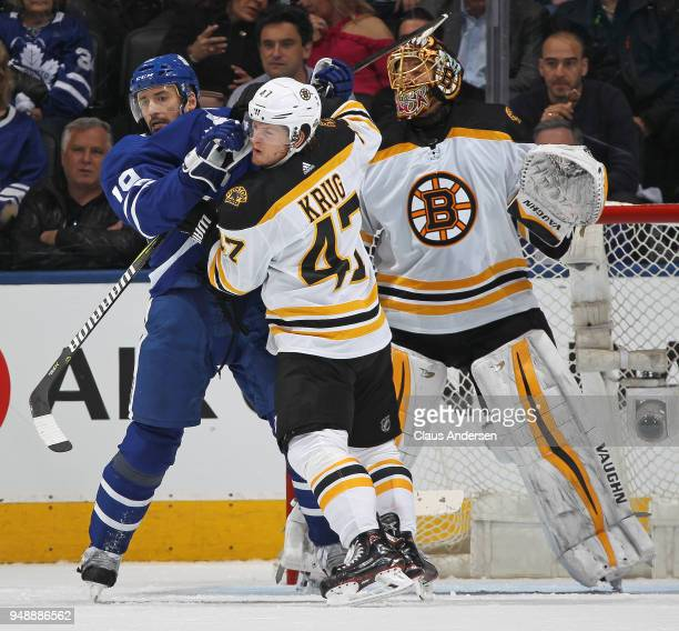 Torey Krug of the Boston Bruins battles against Tomas Plekanec of the Toronto Maple Leafs in Game Four of the Eastern Conference First Round in the...