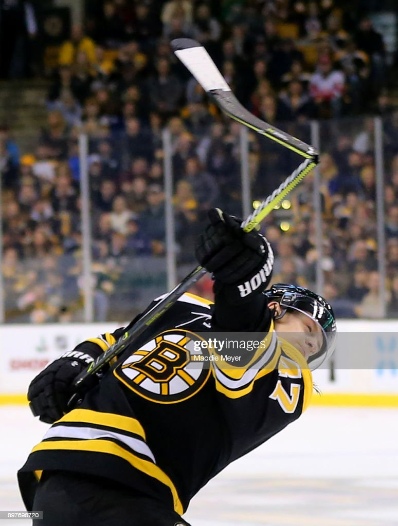 Torey Krug #47 of the Boston Bruins breaks his stick while taking a shot against the Detroit Red Wings during the first period at TD Garden on December 23, 2017 in Boston, Massachusetts.