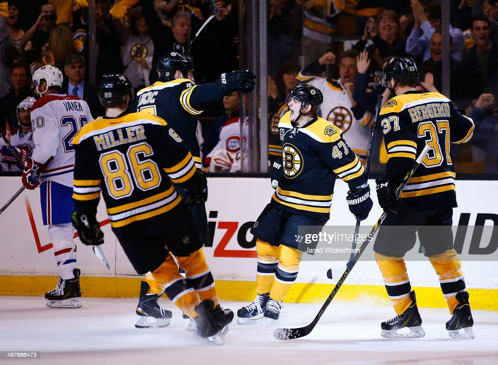 Torey Krug #47 of the Boston Bruins celebrates his goal with teammates in the third period against the Montreal Canadiens in Game One of the Second Round of the 2014 NHL Stanley Cup Playoffs on May 1, 2014 in Boston, Massachusetts.