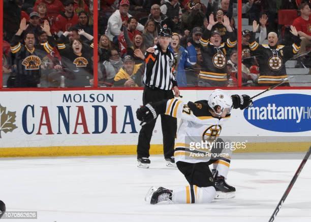 Torey Krug of the Boston Bruins celebrates his overtime winning goal against the Ottawa Senators at Canadian Tire Centre on December 9 2018 in Ottawa...
